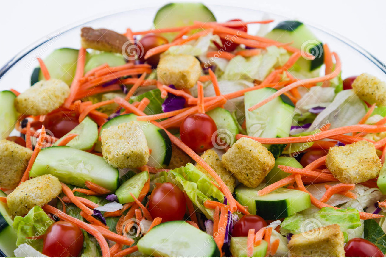 close-up-fresh-garden-salad-tossed-set-against-white-background-35316482